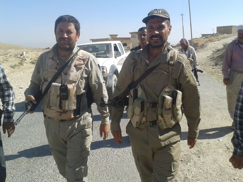 Top Yazidi commander Haydar Shesho (right)